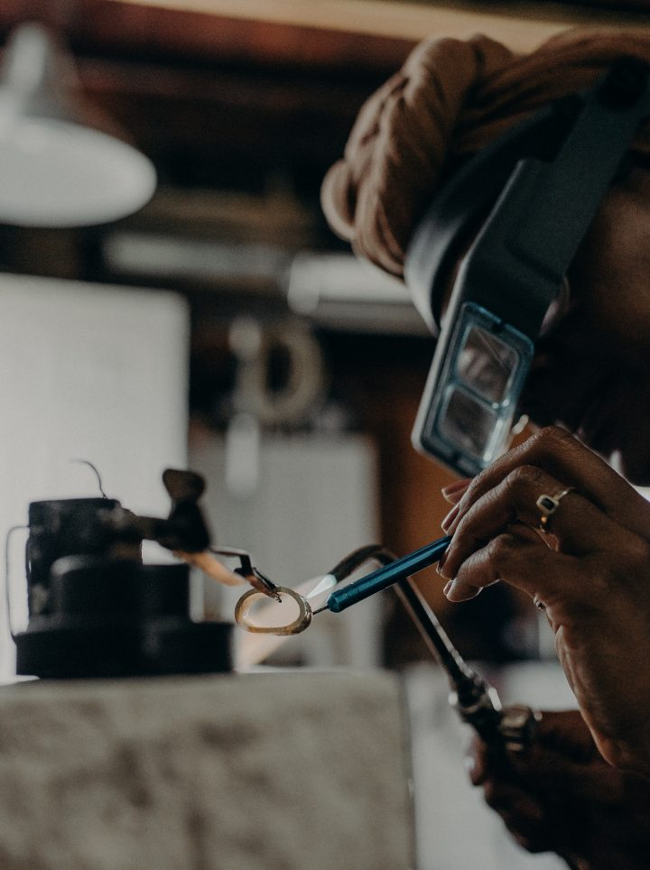 charmaine vegas making a 18k gold wedding band in her Long Beach jewelry studio