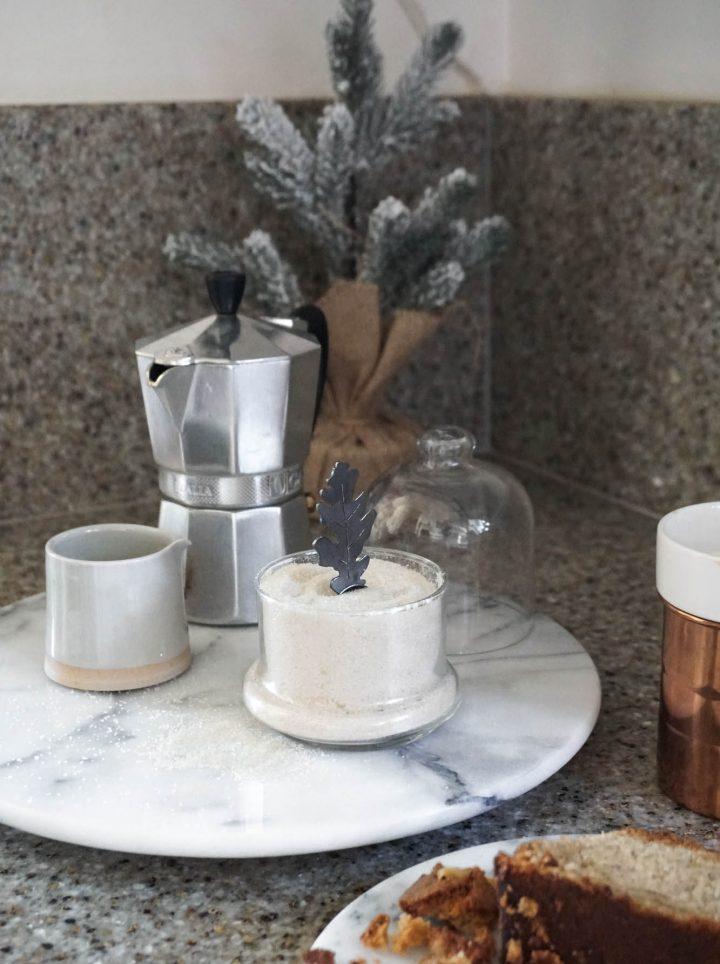 leaf sugar spoon in sugar sand and bell jar